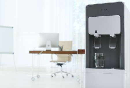 Modern water cooler with glass in office. Space for text