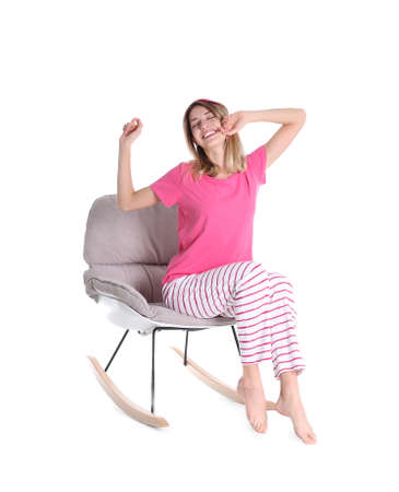 Young woman relaxing in armchair on white background Banco de Imagens