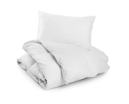 Clean blanket and pillow on white background Imagens