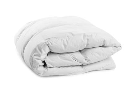 Folded clean blanket on white background. Household textile Imagens
