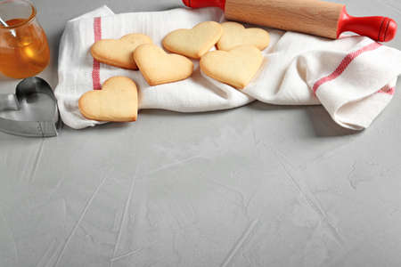 Composition with heart shaped cookies and space for text on table Foto de archivo