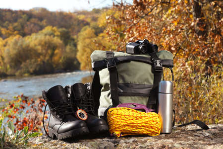 Set of camping equipment on ground outdoors Stockfoto
