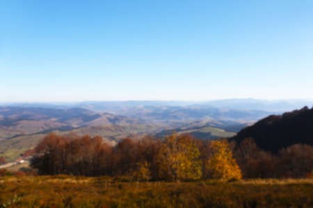 Beautiful mountain landscape with blue sky on sunny day, blurred view 免版税图像