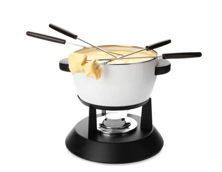 Pot of delicious cheese fondue and forks with bread on white background 写真素材