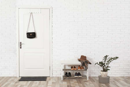 Hall interior with brick wall and white wooden door Stock Photo