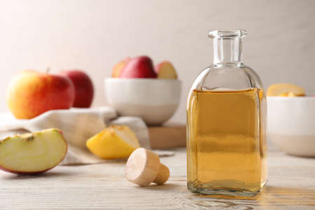 Composition with bottle of apple vinegar on table. Space for text Stock Photo