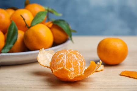 Fresh ripe tangerines on table. Citrus fruit