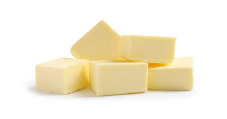 Cut butter on white background. Dairy product