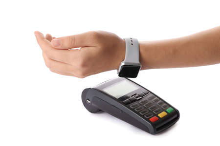 Woman using terminal for contactless payment with smart watch on white background Stock fotó