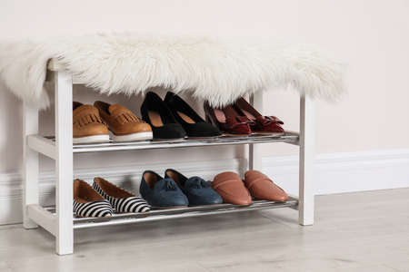 Rack with different stylish shoes indoors. Idea for interior design