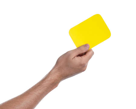 Man holding yellow card on white background, closeup of hand Archivio Fotografico