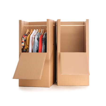 Cardboard wardrobe boxes with clothes on white background