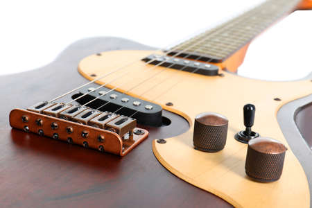 Electric guitar on white background, closeup. Musical instrument