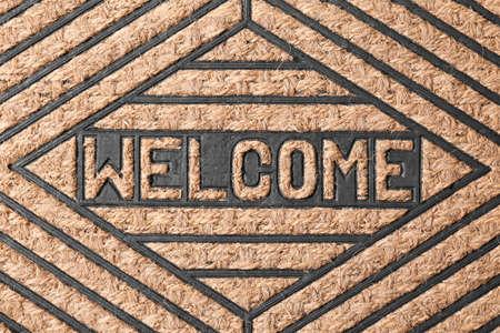 Modern welcome doormat as background, top view