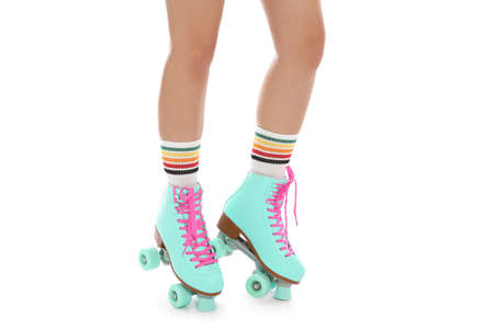 Young woman with vintage roller skates on white background, closeup view Archivio Fotografico