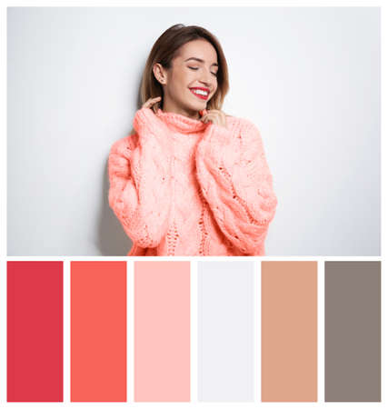 Beautiful young woman in warm sweater on white background. Palette with living coral color