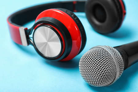 Stylish headphones and microphone on color background, closeup Stock Photo