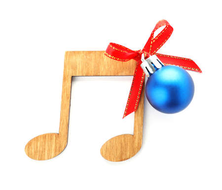 Wooden music note with Christmas ball isolated on white, top view