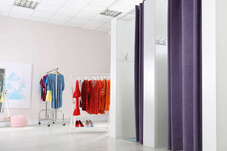 Fashion store interior with dressing rooms. Modern design