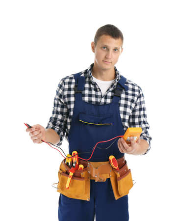 Electrician with multimeter wearing uniform on white background