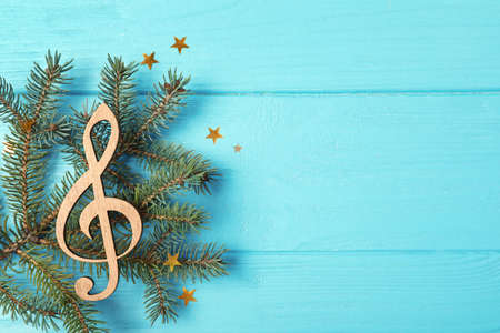 Composition with decorative treble clef and space for text on wooden background, top view. Christmas music concept Stock Photo