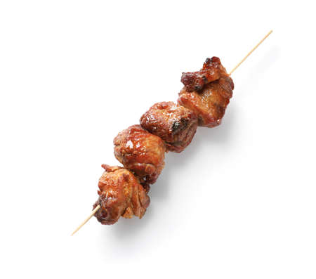 Skewer with delicious barbecued meat on white background