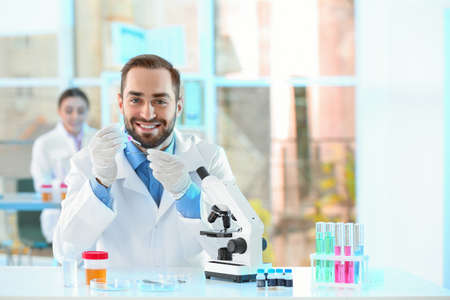 Young scientist working in laboratory, space for text. Chemical analysis