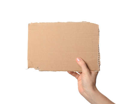 Woman holding piece of cardboard on white background, closeup. Space for text