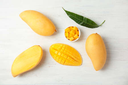 Flat lay composition with mango on wooden background Фото со стока