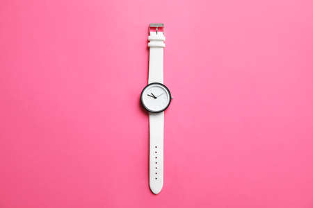 Stylish wrist watch on color background, top view. Fashion accessory Stock Photo