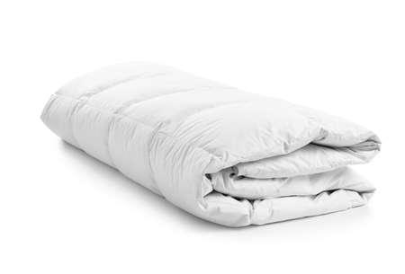 Folded soft blanket on white background. Textile for bedroom interior 免版税图像