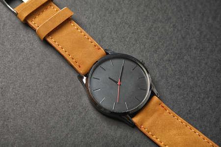 Stylish wrist watch on dark background. Fashion accessory Reklamní fotografie