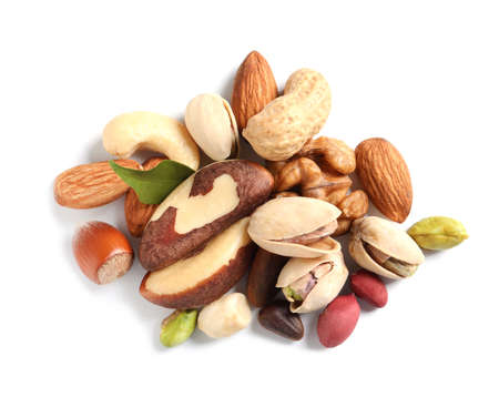 Pile of mixed organic nuts on white background