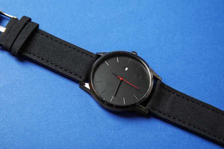 Stylish wrist watch on color background. Fashion accessory
