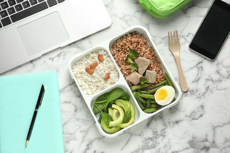 Flat lay composition with container of natural protein food on office table Foto de archivo