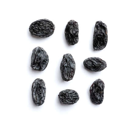 Composition with raisins on white background, top view. Dried fruit as healthy snack