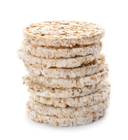 Stack of crunchy rice cakes on white background