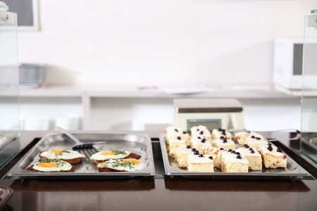 Trays with healthy food in school canteen