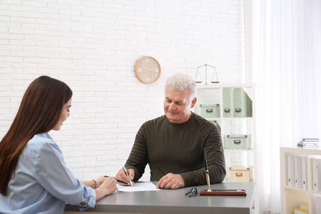 Lawyer having meeting with client in office