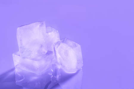 Ice cubes on color background. Space for text