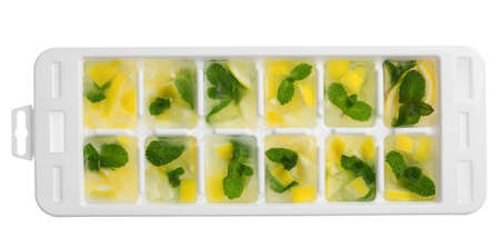 Ice cubes with lemon and mint in tray on white background, top view