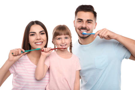 Little girl and her parents brushing teeth together on white background Standard-Bild