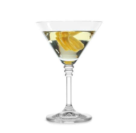 Glass of martini cocktail with lemon zest on white background Foto de archivo