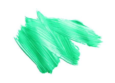 Abstract brushstroke of green paint isolated on white