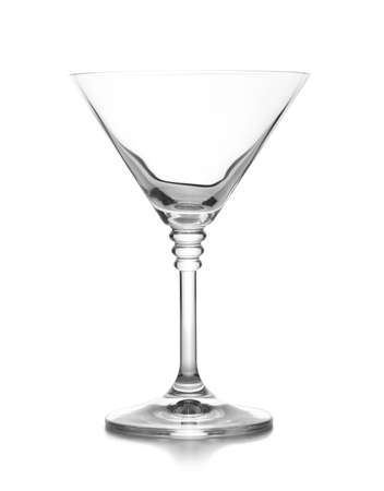 Empty crystal martini glass on white background
