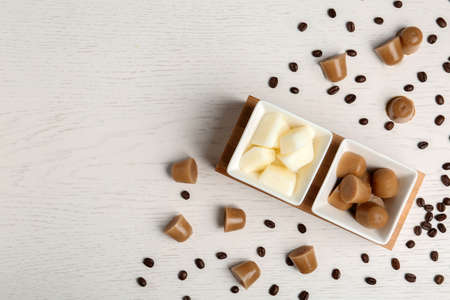 Flat lay composition with milk and coffee ice cubes on white wooden background. Space for text Standard-Bild