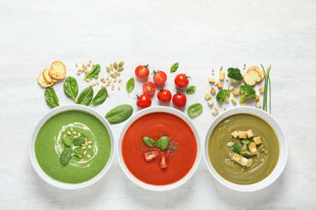 Flat lay composition with various soups and ingredients on white background. Healthy food Stock fotó