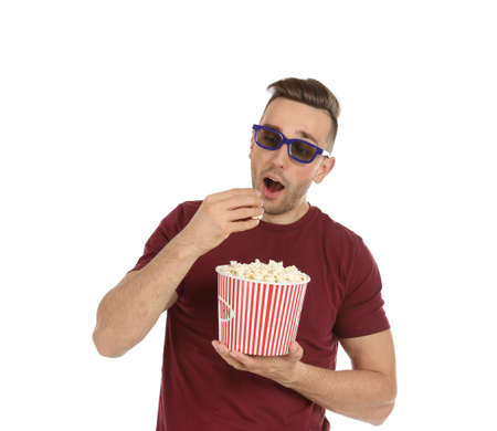 Man with 3D glasses and popcorn during cinema show on white background