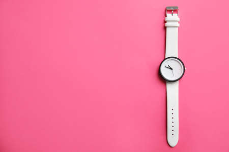 Stylish wrist watch on color background, top view with space for text. Fashion accessory Stock Photo