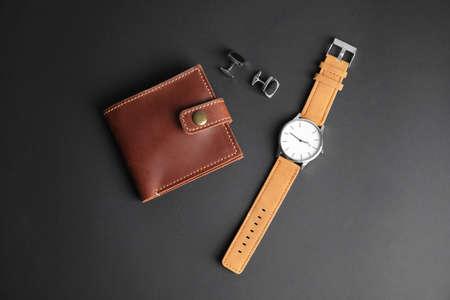 Stylish wrist watch, cuff links and wallet on black background. Fashion accessory Reklamní fotografie